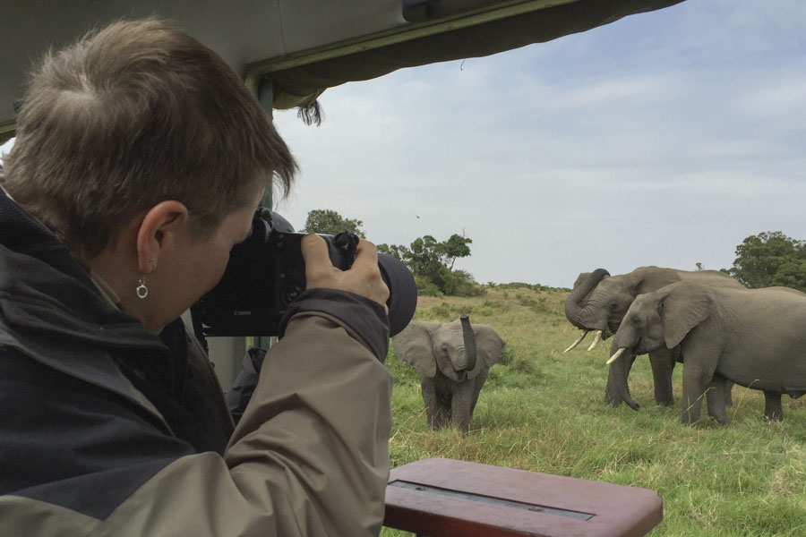 NJ Wight photographing elephants on a Kenya safari.